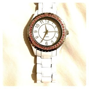 White and pink watch